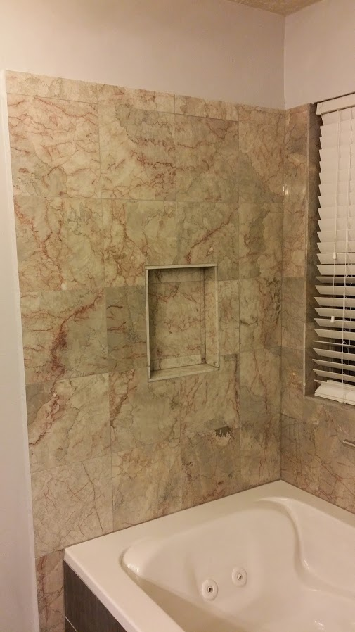 Bathroom repair, jacuzzi tub and marble tile Houston
