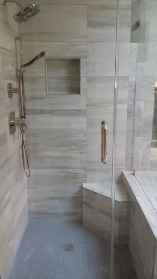 Full shower remodel Houston, memorial, tile, frameless door, porcelain and mosaic tile.