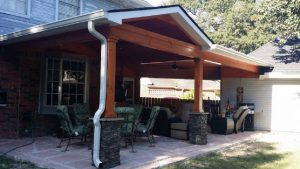 Covered patio room addition Houston with flagstone and roof.