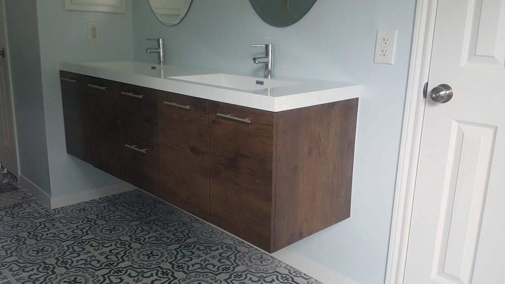 Master bathroom remodel with floating vanity and porcelain tile floor in Kingwood, Tx