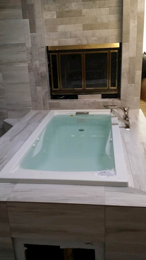 Master bathroom remodel, soaker tub with porcelain tile, Houston.