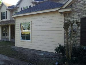 Room addition Katy, Tx hardiplank lap siding, roof and painting.