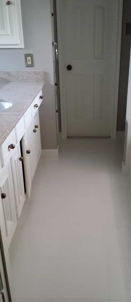 Small bathroom flooring Spring, Tx with large porcelain tile.